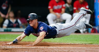 Max Kepler dives for the go-ahead run