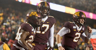 Mohamed Ibrahim, Seth Green, and Tanner Morgan of the Gophers