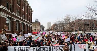 The Caravan of Love: A Walk of Love for Immigrants and Refugees moved from the Minneapolis City Hall down Washington Ave