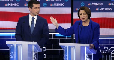 Democratic presidential candidate former South Bend, Indiana Mayor Pete Buttigieg (L) and Sen. Amy Klobuchar (D-MN) participate in the Democratic presidential primary debate at Paris Las Vegas on February 19, 2020 in Las Vegas, Nevada