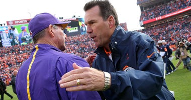 Head coach Mike Zimmer of the Minnesota Vikings and head coach Gary Kubiak of the Denver Broncos meet at midfield following their game at Sports Authority Field at Mile High on October 4, 2015 in Denver, Colorado.