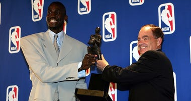 Kevin Garnett #21 of the Minnesota Timberwolves receives the NBA MVP award from Glen Taylor,owner of the Timberwolves on May 3, 2004 at the Target Center in Minneapolis, Minnesota.