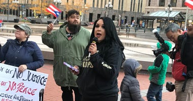Ashley Quinones at rally for her husband killed by police