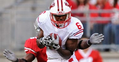 Isaac Anderson catches a ball for the Wisconsin Badgers