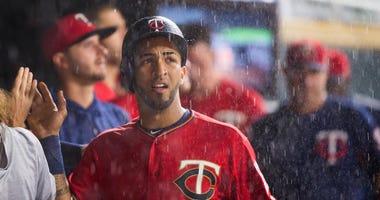 Eddie Rosario looks at the rain