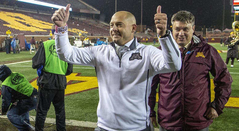Gopher football coach PJ Fleck is happy
