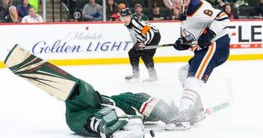 Wild goaltender Devan Dubnyk takes on Ty Rattie of Edmonton