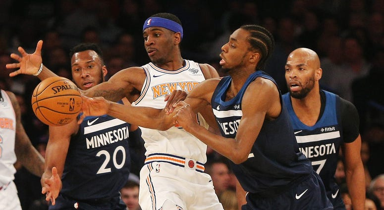 Andrew Wiggins goes for a loose ball