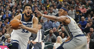 Karl-Anthony Towns has the ball