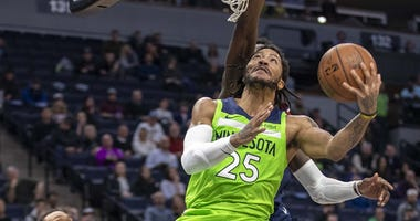 Timberwolves win with Rose