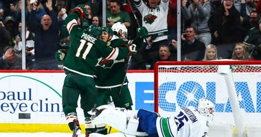 Zach Parise and Jared Spurgeon celebrate a goal