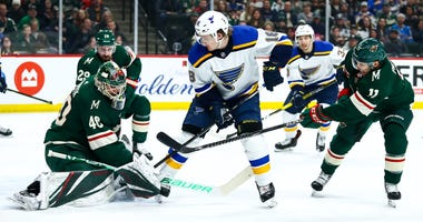 Devan Dubnyk and Zach Parise try to stop Robert Thomas