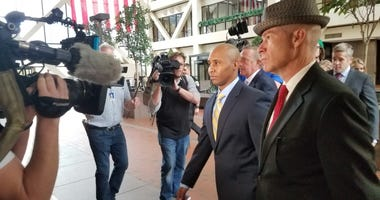 Officer Mohammed Noor (left) arrives with his attorney