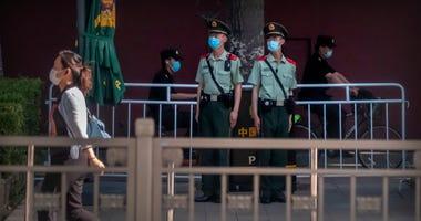 Tiananmen anniversary marked by crackdown, HK vigil ban