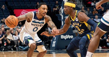 The Minnesota Timberwolves' Jeff Teague (0) works against the Indiana Pacers' Aaron Holiday (3) in the first half at Target Center in Minneapolis on Wednesday, Jan. 15, 2020