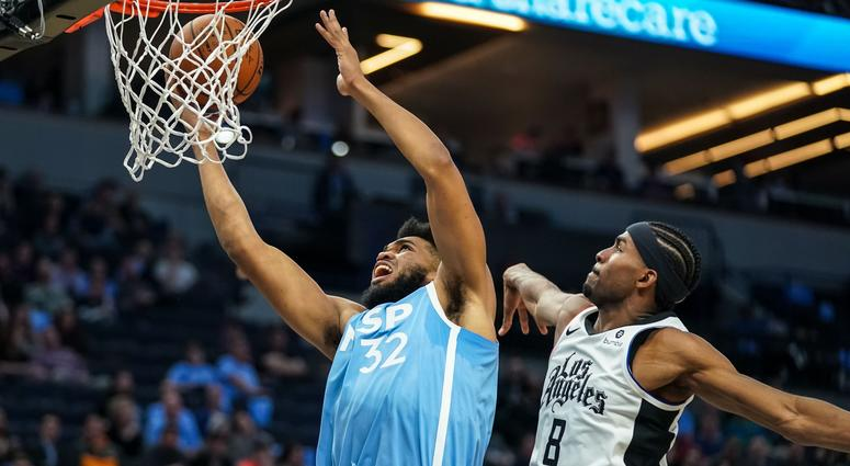 Karl-Anthony Towns of the Wolves beats Maurice Harkless of the Clippers