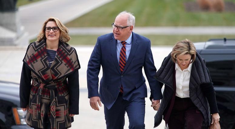 Peggy Flanagan, Gov.-elect Tim Walz, and his wife Gwen