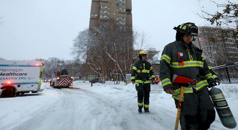 Firefights at the scene of the high rise fire in Minneapolis