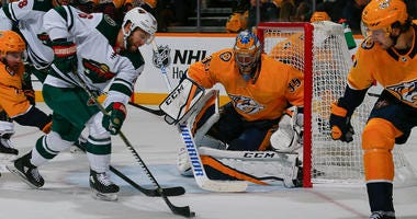 Jason Zucker of the Wild tests Pekka Rinne
