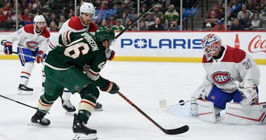 Wild defenseman Jared Spurgeon shoots against the Canadiens
