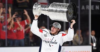 TJ Oshie raises the Stanley Cup