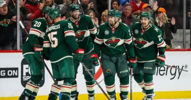 The Wild celebrate goal by Dumba