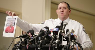 Mug shot of Jake Patterson is shown by sheriff Chris Fitzgerald