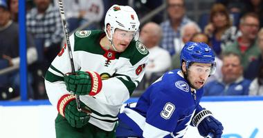 Ryan Donato of the Wild takes on Tyler Johnson of the Lightning