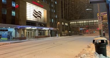 Snow falls in downtown Minneapolis on November 27, 2019.