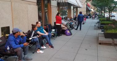 Folks waiting to buy Hamilton tickets