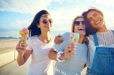Laughing teenage girls eating ice cream cones