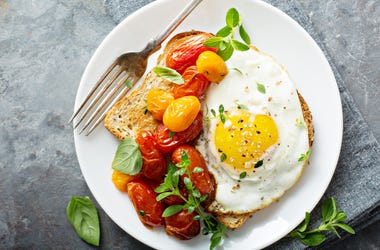 Photo of Multigrain toast with fried egg and roasted tomatoes