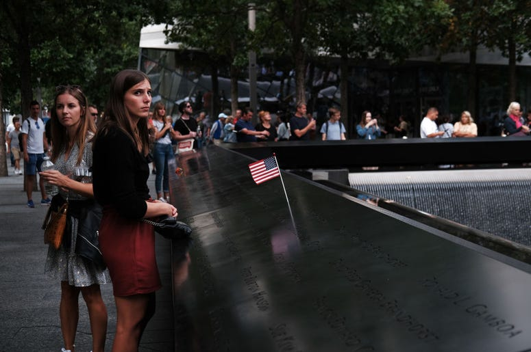People walk on the grounds of the September 11 Memorial and Museum on September 05, 2019 in New York City. New York City is preparing to commemorate the 18th anniversary of the attacks on the World Trade Center in which 2,996 people were killed and over