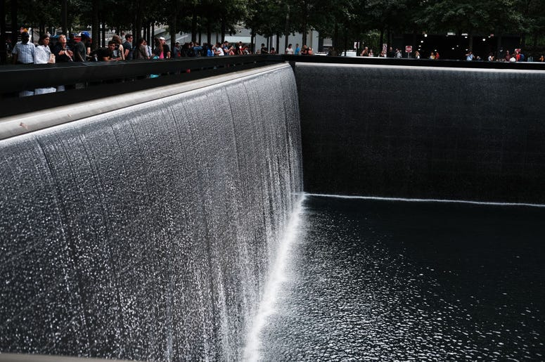People walk on the grounds of the September 11 Memorial and Museum on September 05, 2019 in New York City. New York City is preparing to commemorate the 18th anniversary of the attacks on the World Trade Center in which 2,996 people were killed and over 6