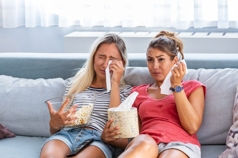 Two Women Crying While Watching A Move