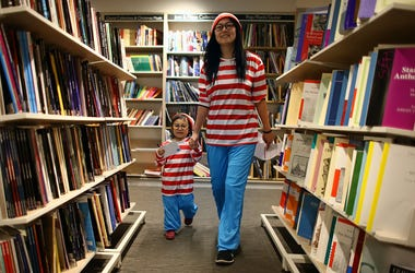 Woman and child in Waldo costumes