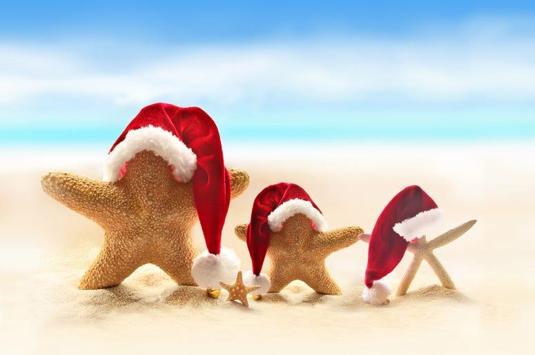 Starfish on summer beach and Santa hat