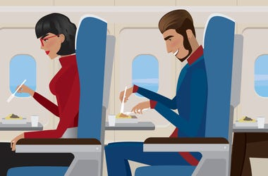 Woman and Man On Airplane