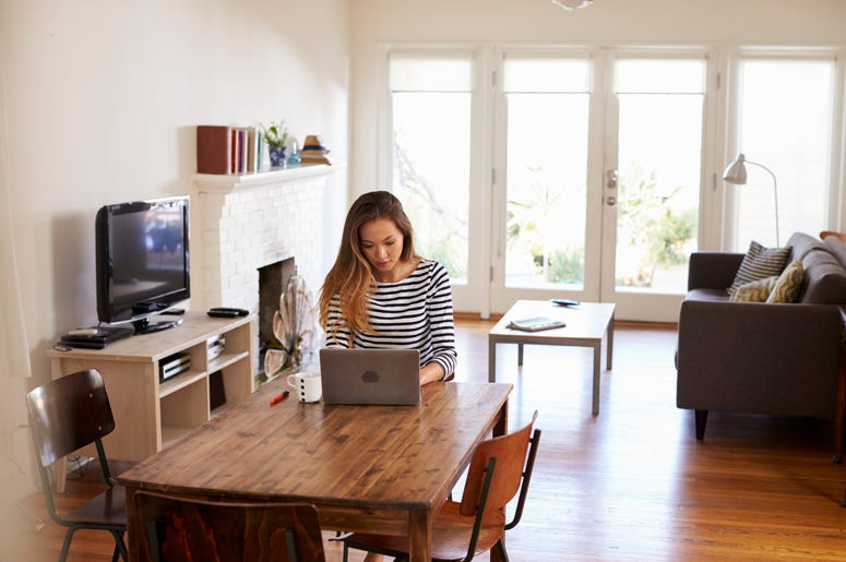 Woman Sitting At Computer Working From Home