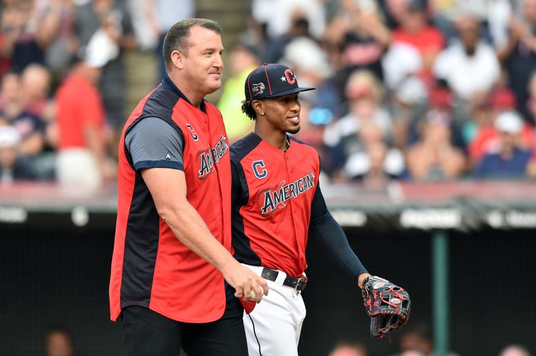 American League infielder Francisco Lindor of the Cleveland Indians hugs Indians former player Jim Thome prior to the 2019 MLB Home Run Derby at Progressive Field.