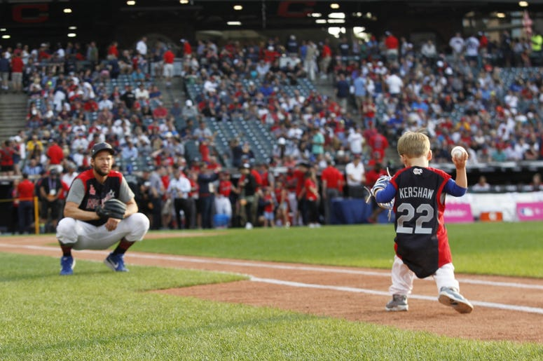 National League pitcher Clayton Kershaw of the Los Angeles Dodgers with his son Charley prior to the 2019 MLB Home Run Derby at Progressive Field.