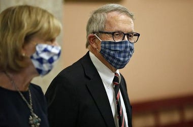 Ohio Gov. Mike DeWine and First Lady Fran DeWine leave the State Room after giving an update on the state's response to the ongoing COVID-19 pandemic Tuesday, April 10, at the Ohio Statehouse. Dewine Facemask