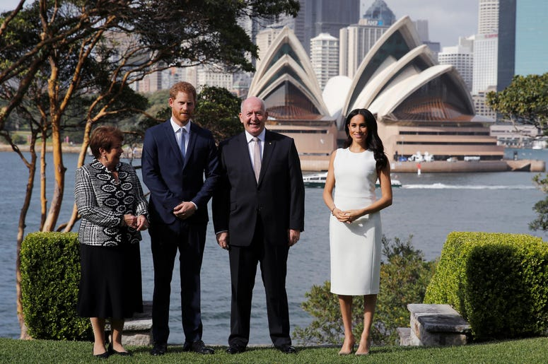 The Duke and Duchess of Sussex, Australia's Governor General Peter Cosgrove and his wife Lynne Cosgrove stand in the grounds of Admiralty House in Sydney, with a view of the Sydney Opera House, on the first day of the royal couple's visit to Australia
