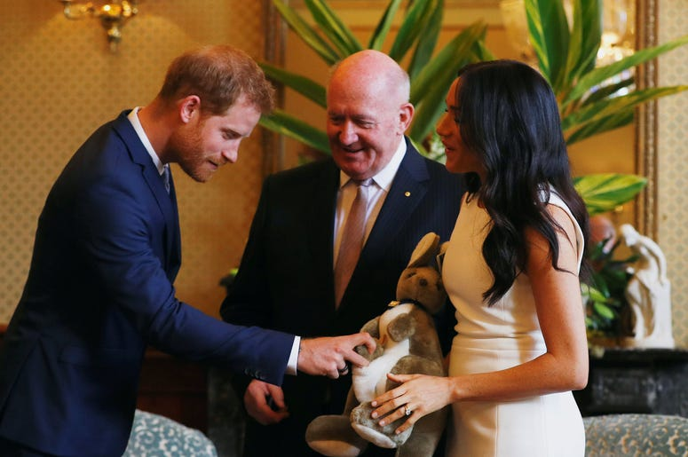 Australia's Governor General Peter Cosgrove gives the Duke and Duchess of Sussex a toy kangaroo - with a baby - at Admiralty House in Sydney on the first day of the royal couple's visit to Australia
