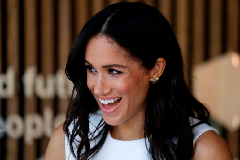 The Duchess of Sussex reacts during a ceremony at Taronga Zoo in Sydney, Australia.