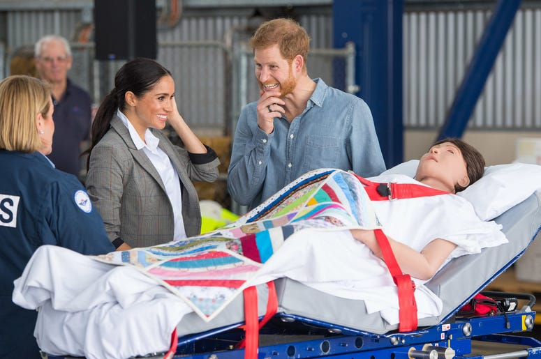 he Duke and Duchess of Sussex look at a medical training aid designed to simulate a pregnant patient as they attend the naming and unveiling of a new Royal Flying Doctor Service aircraft at Dubbo City Regional Airport, in Dubbo, New South Wales, on the se