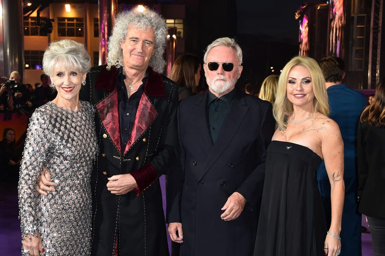 Brian May with wife Anita Dobson with Roger Taylor and wife Sarina Potgieter attending the Bohemian Rhapsody World Premiere held at the the SSE Arena, Wembley, London.