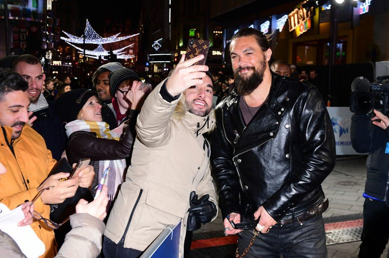 Jason Momoa has a selfie taken with a fan at the Aquaman premiere held at Cineworld in Leicester Square, London.