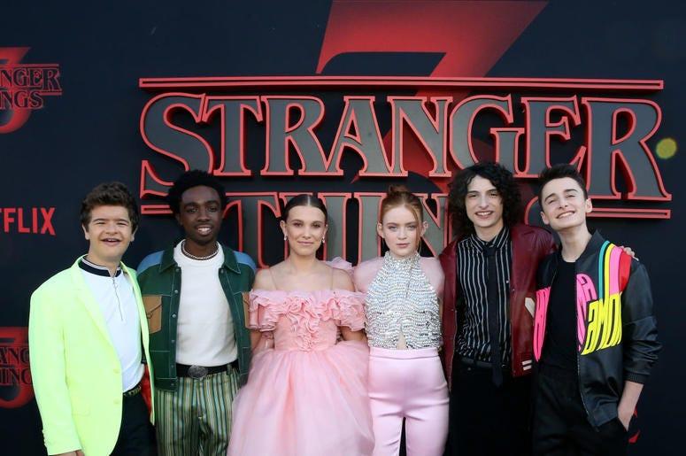 "Gaten Matarazzo, Caleb McLaughlin, Millie Bobby Brown, Sadie Sink, Finn Wolfhard, and Noah Schnapp attend the ""Stranger Things"" Season 3 World Premiere"