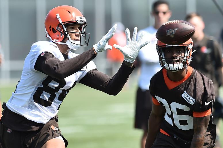 Cleveland Browns wide receiver Derrick Willies (84) catches a pass ahead of cornerback Greedy Williams (26) during training camp at the Cleveland Browns Training Complex.